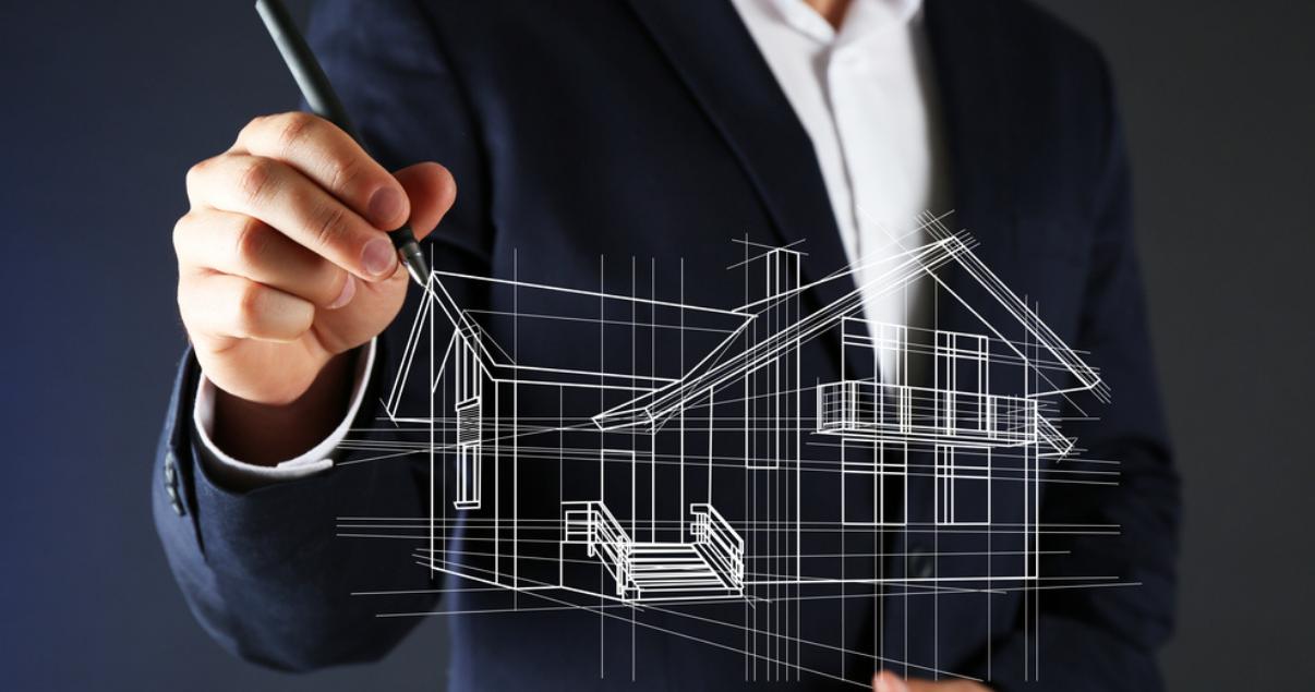 Persona diseñando una propiedad basada en la sustentabilidad inmobiliaria.